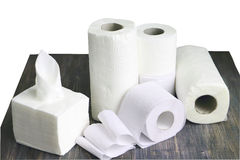 White kitchen paper towel, toilet paper, paper tissue on a dark wooden table Stock Image