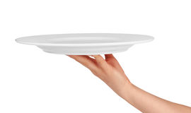 Plate on hand Royalty Free Stock Photography