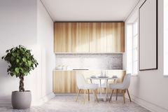 White kitchen with a poster, wood countertops front Stock Photo