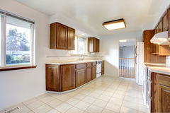 White kitchen room with brown cabinets Royalty Free Stock Image