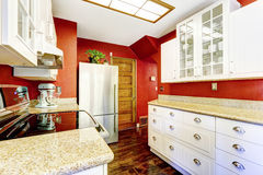 White kitchen room with contrast bright red walls Royalty Free Stock Photos
