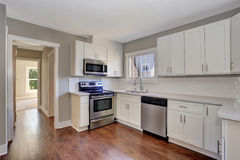 White kitchen room interior with marble counter top and hardwood floor. Northwest, USA stock photo