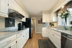 White kitchen in suburban home Stock Photo