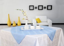 White kitchen table cloth. With flowers and decorative objects Royalty Free Stock Photos
