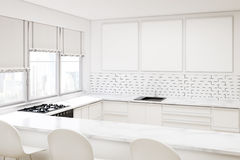 White kitchen with three posters Stock Image