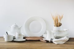 Free White Kitchen Utensils, Dishware And Other Different White Stuff For Serving On White Wooden Board. Royalty Free Stock Photos - 112551098