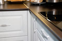 White kitchen. Wooden kitchen. Modern furniture and kitchen interior. Kitchen to individual sizes. Russia, Leningrad region, stock image