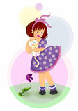 White kitten. A little girl holding her cat in a spring windy day Royalty Free Stock Photo