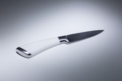 White knife on a table Stock Photography