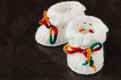 White knitted baby booties Royalty Free Stock Photo