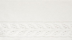 White knitted background. White background with a knitted pattern Royalty Free Stock Images