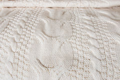 White knitted blanket covers a bed Stock Images