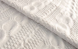 White knitted blanket folded diagonally Royalty Free Stock Photos