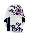 White knitted cap with a scarf. Royalty Free Stock Photo
