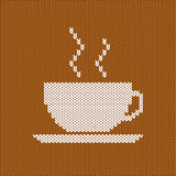 White knitted cup of coffee or tea Stock Images