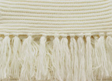 White knitted fabric with tassels Stock Images