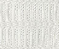White Knitted Fabric Texture.White knitted carpet closeup.  Stock Photography
