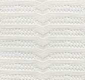 White Knitted Fabric Texture.White knitted carpet closeup.   Stock Image