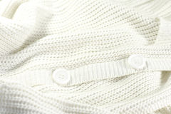 White knitted jacket with buttons Royalty Free Stock Images