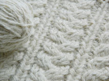 White knitted pattern. `Braids` and ball of of yarn Stock Images
