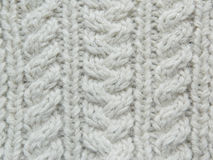 White knitted pattern. Knitted white pattern with the help of needles Stock Photo