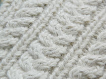 White knitted pattern. Knitted white pattern with the help of needles Royalty Free Stock Image