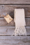 White knitted scarf with fringe on vintage background. Stock Photography