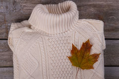 White knitted sweater with a maple leaf. royalty free stock photo