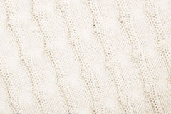 White knitted texture with ornament Stock Images