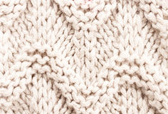 White knitting background texture. Knit woolen Fabric textile mu Stock Image