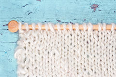 White knitting on rustic background Stock Images