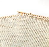 White knitting on white background Stock Image