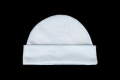 White knitting wool baby hat isolated on black Royalty Free Stock Photo