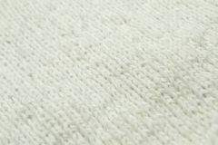 White knitting wool texture background. Texture of knitted woolen fabric for wallpaper and an abstract background Royalty Free Stock Photography