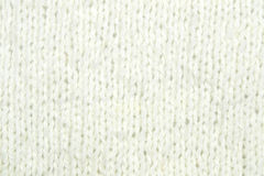 White knitting wool texture background. Texture of knitted woolen fabric for wallpaper and an abstract background Royalty Free Stock Photos
