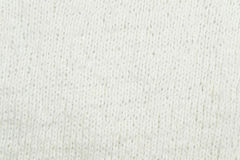 White knitting wool texture background. Texture of knitted woolen fabric for wallpaper and an abstract background Royalty Free Stock Image
