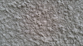 White knobby cement wall Stock Photo