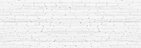 White knotty wooden plank wide texture. Whitewashed horizontal wood board panorama. Long panoramic rustic background. White knotty wooden plank wide texture royalty free stock images