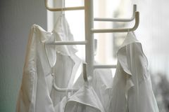 White lab dressings gown on a hanger. Moscow, Russia - September, 24, 2018: White lab dressings gown on a hanger in a class in Moscow privet school stock photography