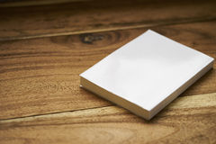 White label book with plane cover. Book with white cover on the wooden table, ready for you to put your own cover to it royalty free stock image