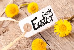 White Label, Dandelion, English Calligraphy Happy Easter. White Label With English Calligraphy Happy Easter. Dandelion Blossom On Wooden Rustic Background royalty free stock photos