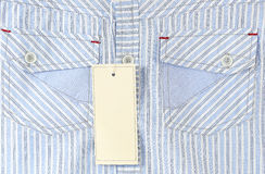 White label on the shirt. White label on the blue shirt Royalty Free Stock Photo