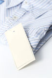 White label on the shirt. White label on the blue shirt Royalty Free Stock Images