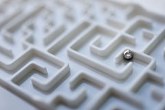 White labyrinth and metal ball, complex problem solving concept. royalty free stock photography