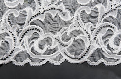White lace. With pattern in the manner of flower on black background Royalty Free Stock Image