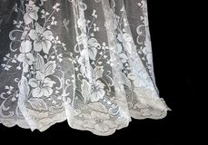 White Lace. Curtain against black background royalty free stock photo