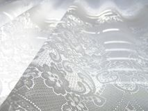 White Lace. High-key abstract white lace background stock image