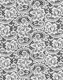 White lace. Flowered  white lace on black background Stock Image
