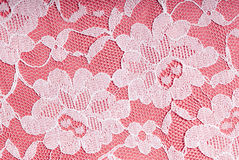 White lace. On a pink background Royalty Free Stock Images