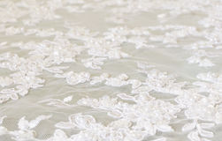 White lace background. With with embroidery and beads Royalty Free Stock Photography